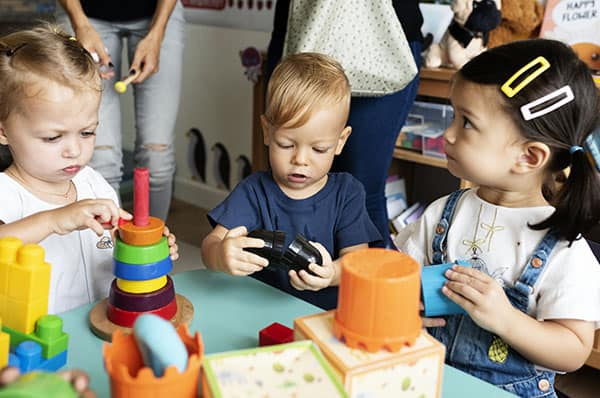 Young children playing with toys in classroom