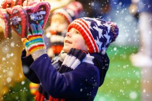Little boy with Gingerbread at Christmas market