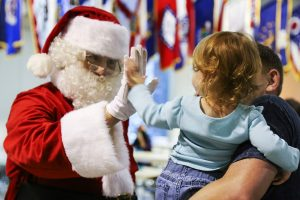 Santa Claus visiting with child